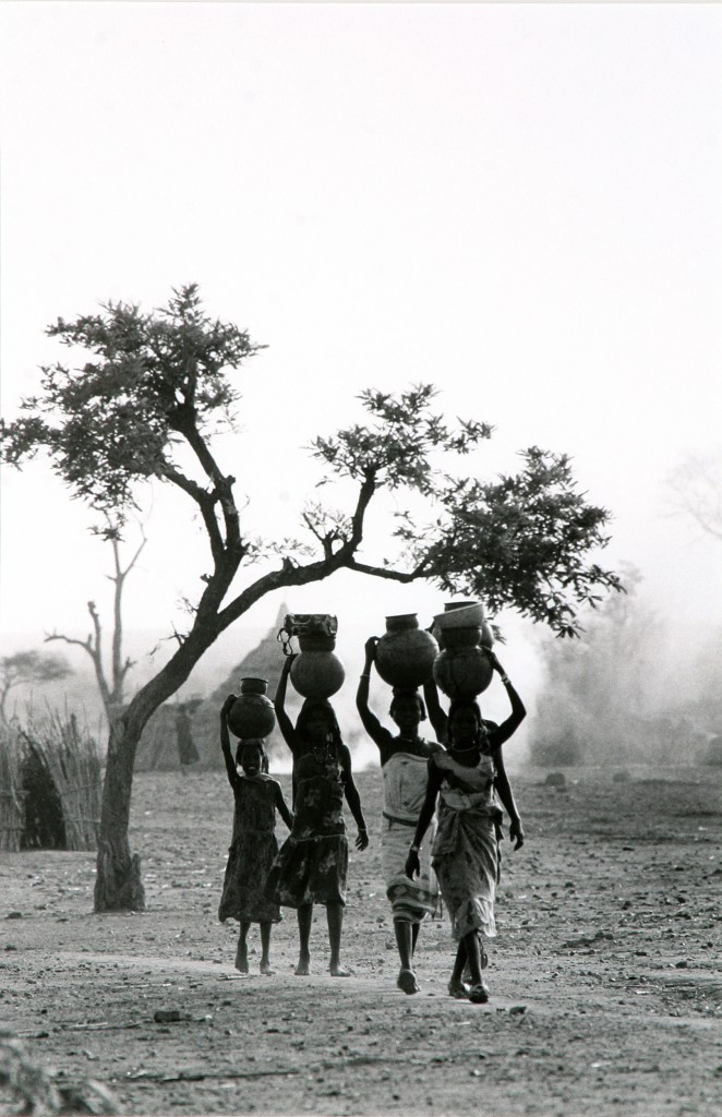 Watercarriers, Western Darfur, Sudan by Padraig Grant